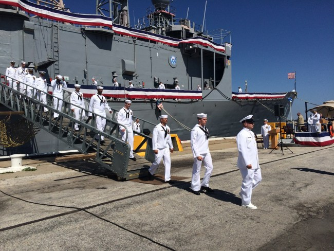 The crew of USS Samuel B. Roberts leaves their ship for the last time on May 22, 2015.