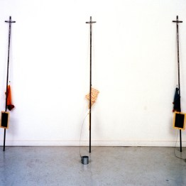 Saved and Damned, 1992, steel, slates, puppets and chains (3 units), 6 x 72 x 3 inches (each unit)