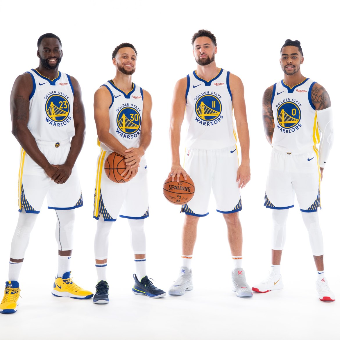 Draymond Green #23, Stephen Curry #30, Klay Thompson #11, and D'Angelo Russell #0 of the Golden State Warriors pose for a portrait during Media Day 2019