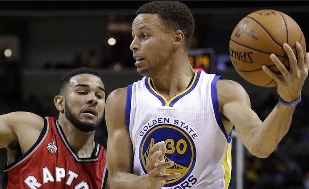 Cory Joseph y Stephen Curry