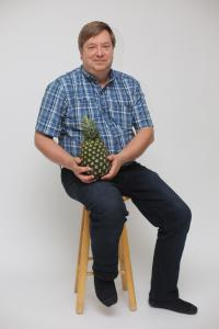 Struggling, but why, when this man can so gracefully enjoy a pineapple.