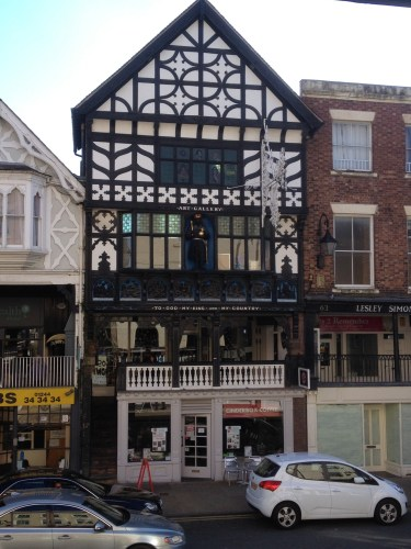 """Victorian building showing """"The Rows"""". These are the tiered levels which now house shops"""