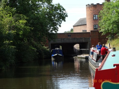 Looking back at the top lock from our mooring below, and seeing it in action with a boat exiting and one waiting to enter