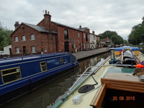 Passing the Swan Inn and shop at Fradley Junction