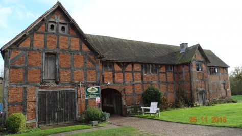 Tudor stable block that now has been converted to craft shops and cafe