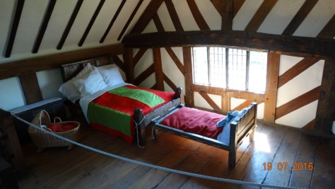 Upstairs bedroom  with cot at the foot of the bed