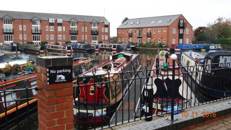 boats moored in the arm surrounded by newly built apartments