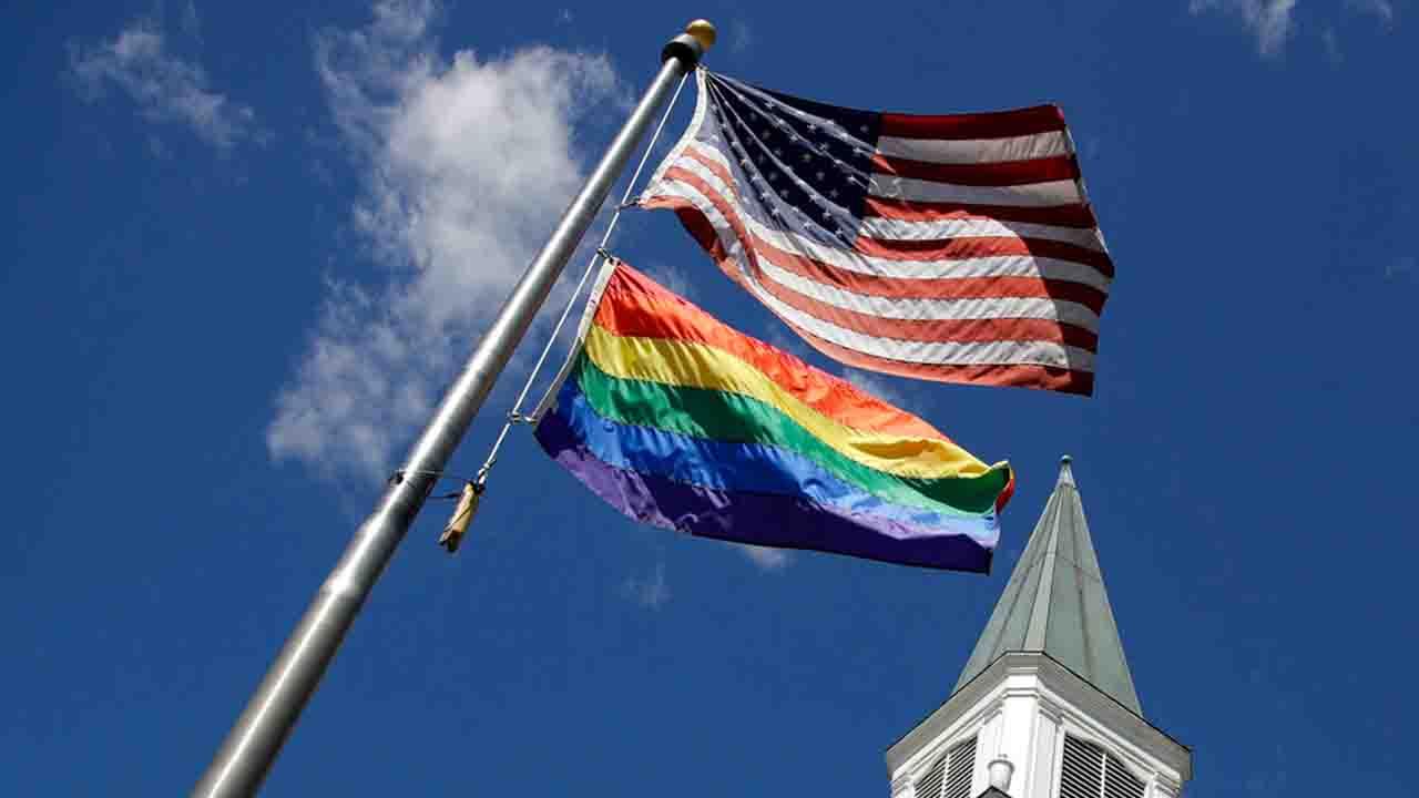 Gay Pride Flag and American Flag_1555778278438.jpg.jpg