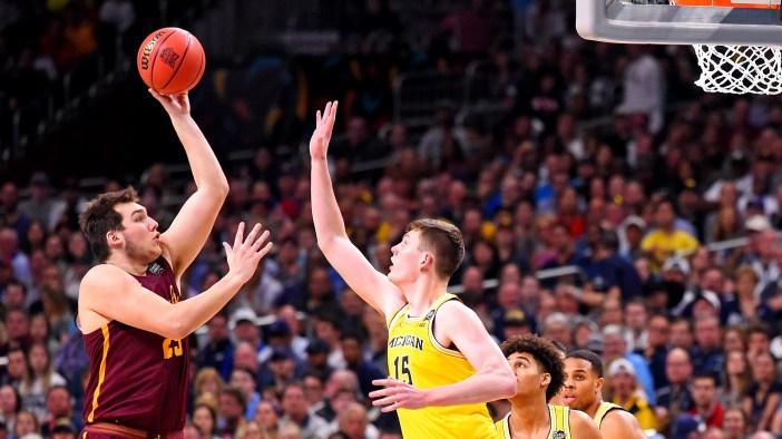 Loyola Chicago's Cameron Krutwig shoots over Michigan's Moritz Wagner