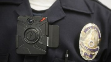 Increasing the use of police body cameras will create a rise in video evidence