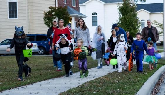 Children go trick-or-treating on Halloween