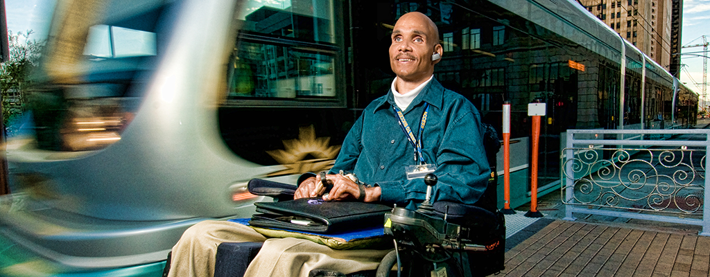 Photo by Arizona Bridge to Independent Living – a man with a disability exists the Light Rail
