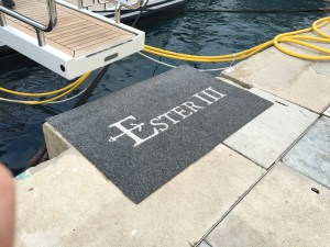 Love the anchor designed into the letters on this yacht's coordinating mat!