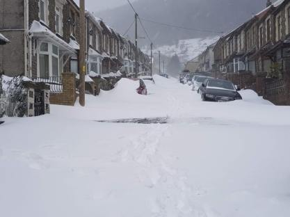 Street and Valleys Covered in Snow