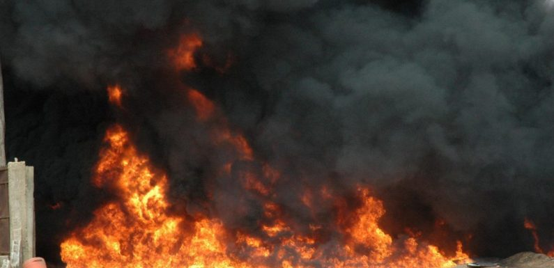 Irate youths set commercial vehicle ablaze after crushing two brothers in Delta