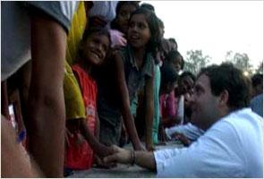 Rahul Gandhi breaks security cordon to meet children