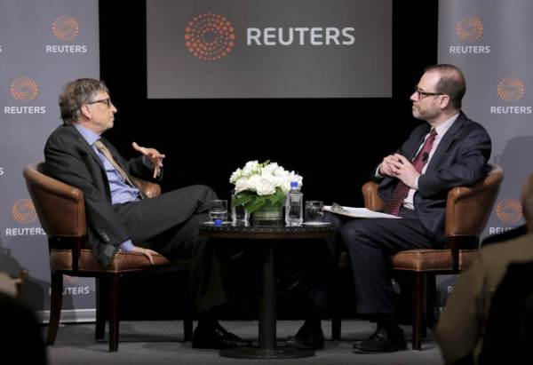 Another Take: photo of Bill Gates and Steve Adler of Reuters.
