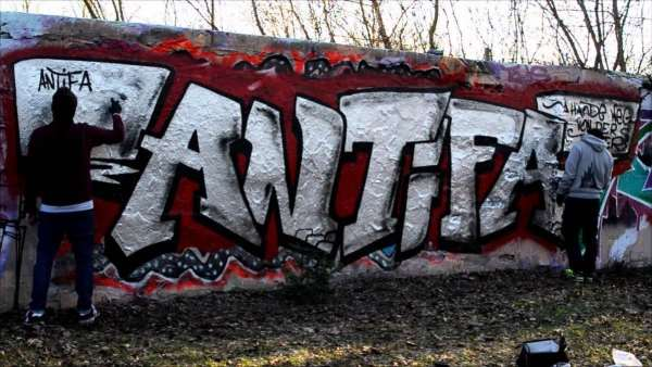 "Antifa-sters: photo of ""Antifa"" graffiti on a wall."