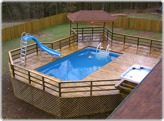 wooden deck with pool and slide