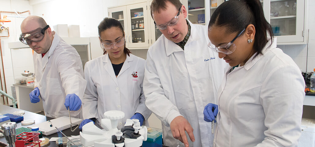 Three student run testing under the close watch of a faculty member