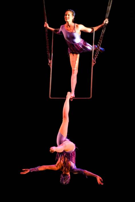 photo of NECCA's founders performing on aerial rectangle