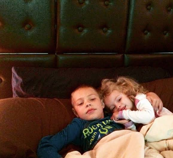 Cuddling your baby sister