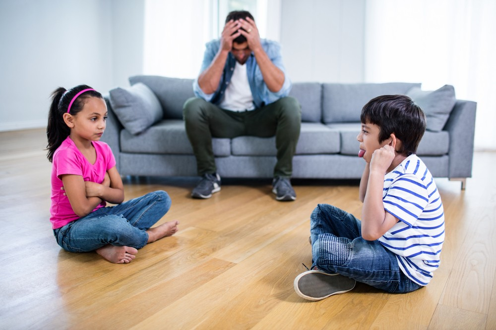 parents settling conflicts among siblings in the family
