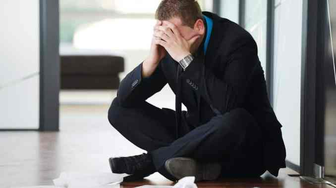 man suffering from unemployment depression