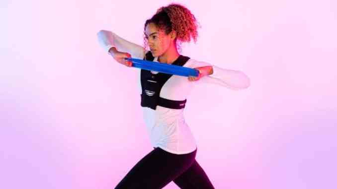 woman using freetrain v1 vest for workout