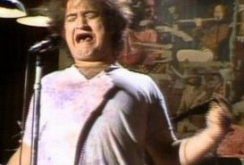 John Belushi as Joe Cocker
