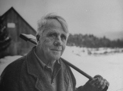 Robert Frost with axe