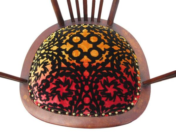 Close-up of seat of 'Sunset' Spindle chair with Christian Lacroix designer fabric.