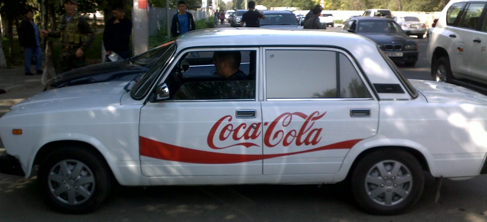 taxi with a coke ad on the side