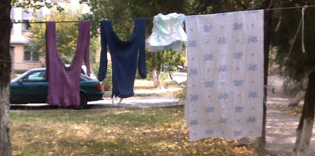 clothesline with worn clothes and a disposable diaper