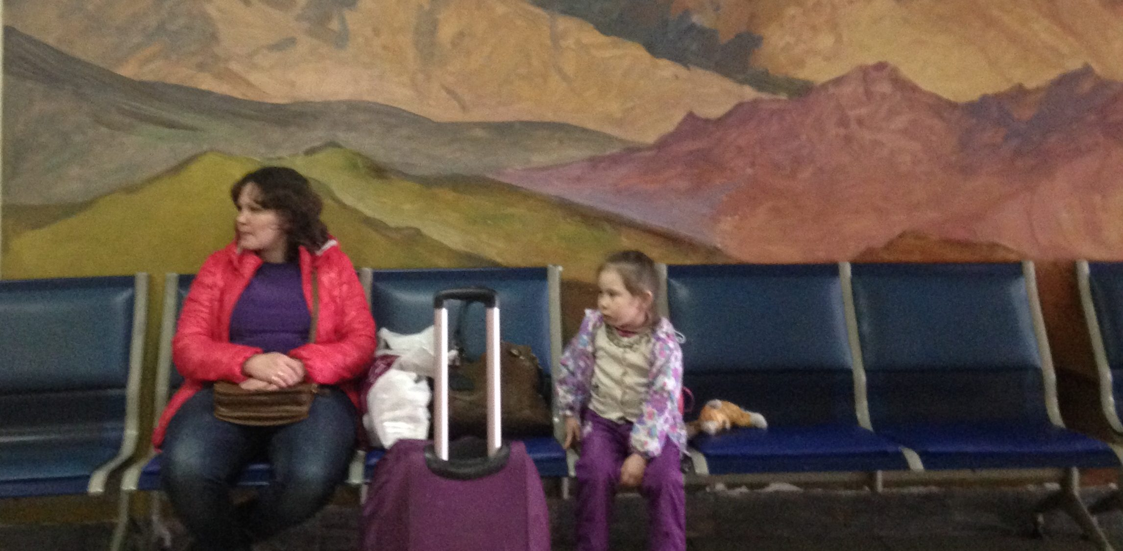 a woman and a child in an airport