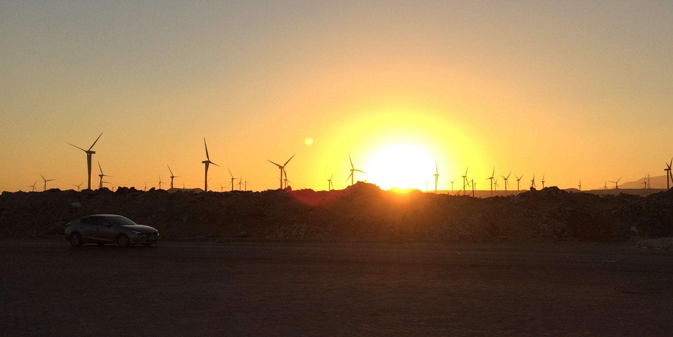 sunset over a wind farm
