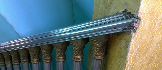 a railing next to a staircase