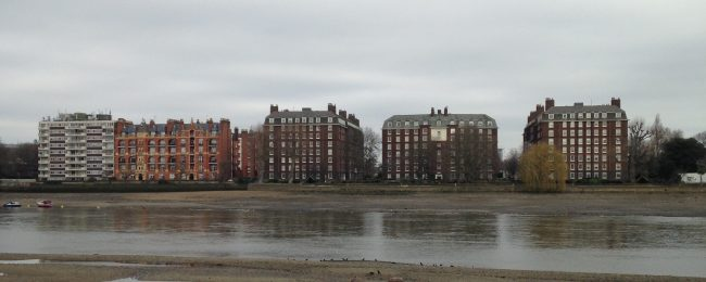 row of houses on a river in London