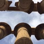 A photo looking up at ancient egyptian pillars
