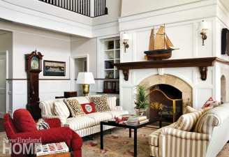 A palette of soft neutrals punctuated with bright red brings a breezy air to the living room.