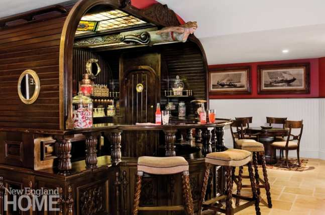 An antique bar is the focal point of the lower-level family room.