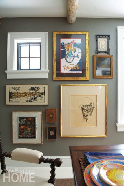 The dining room art is an entrancing collection of vintage, antique, and thrift-store finds.