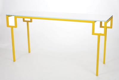 "A yellow base gives Jose Pascual's Gorge console table a modern twist. Reminiscent of an Asian painting table, the console would look equally good gracing an entry hall or tucked behind a living room sofa. The console has a powder-coated steel base and a top of white glass. SHOWN, 60"" HIGH X 19"" WIDE X 29.5"";DEEP. $2,500. LEKKER HOME, BOSTON, (617) 542-6464, LEKKERHOME.COM"