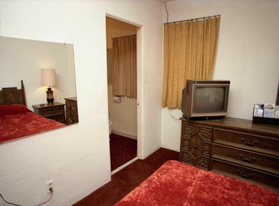 "Motel room with red plush bedspread (1976), 30"" x 40"""