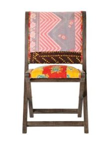 "Well, actually that's usually where you'd stash a folding chair, but the vivid embroidered and upholstered Terai Folding Chair is too good looking to hide. The chair is available in three fabrics including Floral Tapestry, shown here. 33""H, 18""W, 18""D. $198. ANTHROPOLOGIE, BOSTON, (800) 309-2500, www.ANTHROPOLOGIE.COM"