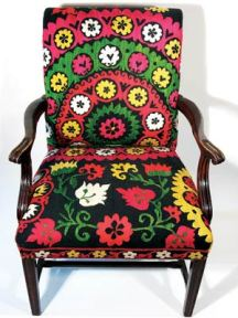 "Pat Stanton became so enamored with Suzanis, handmade cotton and silk textiles from central Asia, that she built her business around them, marrying the rich textiles to wood framed furniture. She uses a circa 1960s version of the fabric for her Tulip Chair. 25""W X 23""D X 35""H. $1,150. KARMA, NEWTON CENTRE, MASS., (617) 965-2822, www.COMETOKARMA.COM, OR HOMESTYLE, PROVIDENCE, R.I., (401) 277-1159, www.HOMESTYLE.COM, www.STANTISTANDESIGN.COM"