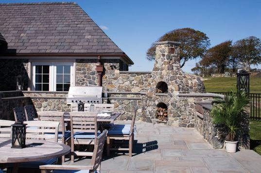 Much of the stone for the cladding, terrace walls and outdoor fireplace came from the site.