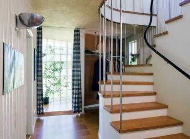A curved handrail adds a playful touch to the staircase.