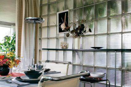 A dining room wall consists of glass block, revolutionary then, now modernism's iconic material.