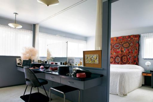 A black, white and gray palette, punctuated with red, makes for sophisticated dynamism in a small house.